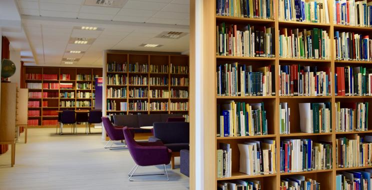 the image shows the inside of a Library that is filled with books and resources