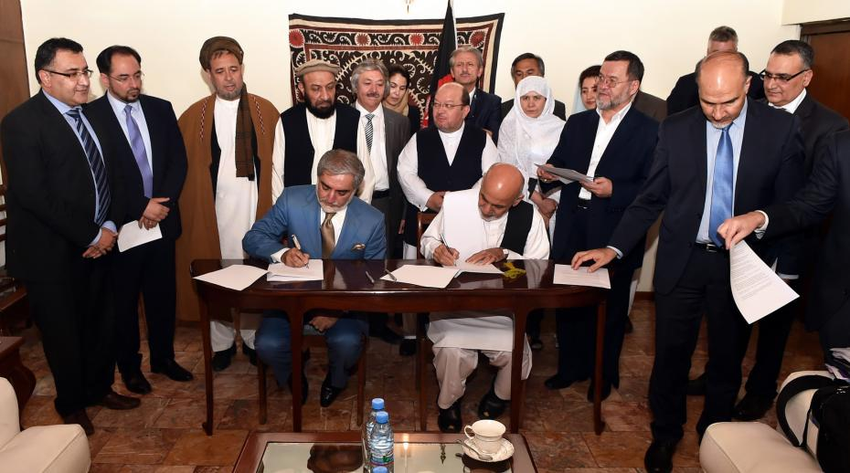 Afghan presidential candidates Abdullah Abdullah and Ashraf Ghani sign the Joint Declaration of the Electoral Teams in Kabul, Afghanistan in 2014